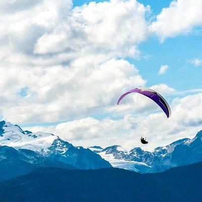 Pilot Guy Herrington flying over the Pemberton Mountains