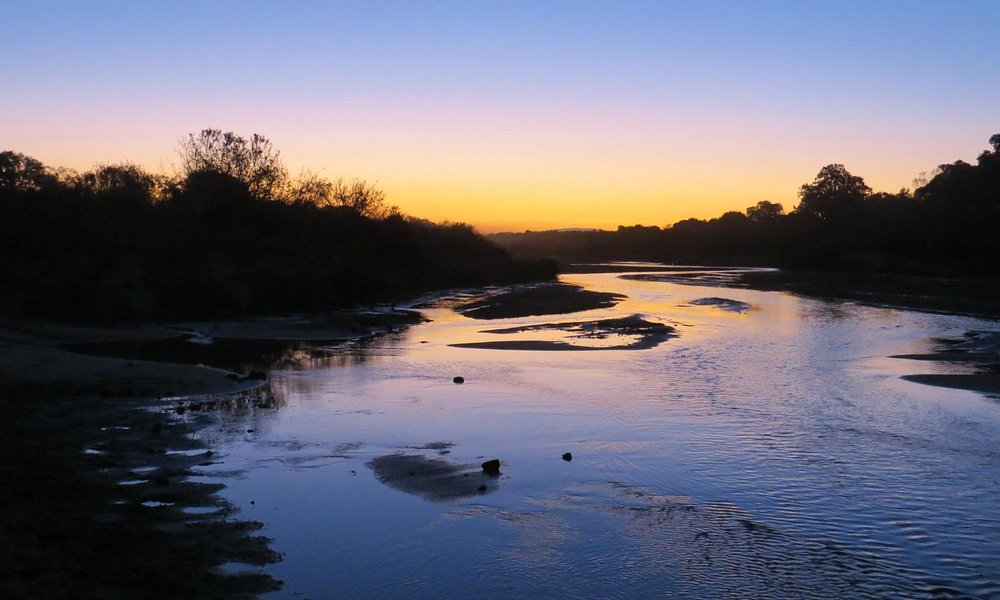 Sunset over the Sand River
