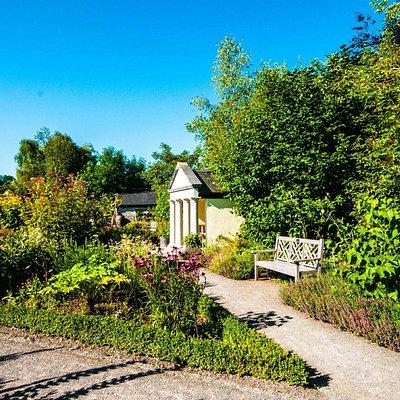Pathways around the garden with a sitting area