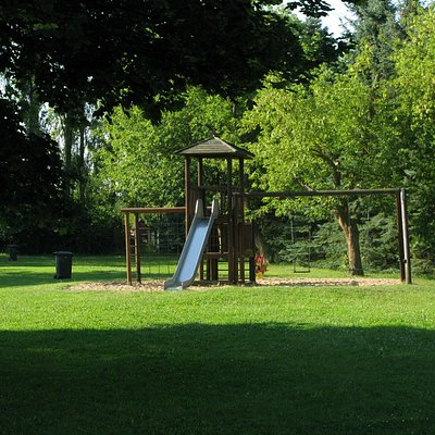 There are several lawned areas and a climbing frame.
