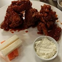Chicken wings-more like an entire chicken. Very tasty. Lightly spicy buffalo sauce with a delici