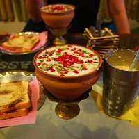 Pomegranate Lassi, toast, and iced coffee