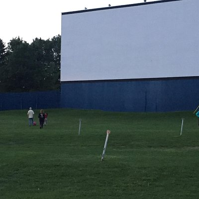 Children and families playing ball before the movie starts.