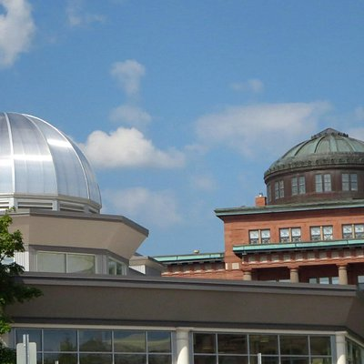 The dome of the history museum, on the left, honoring the classic dome of the County Courthouse