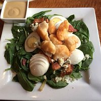 The very filling salad with scallops, bacon, eggs