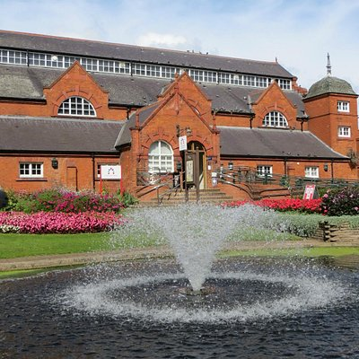 Queens Park Fountain with Charnwood Museum in background