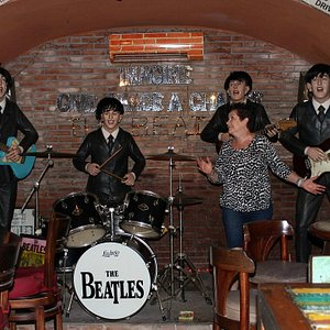On stage with the Beatles.