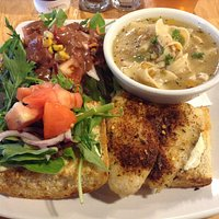 Blackened fish half sandwich with salad and chicken noodle soup