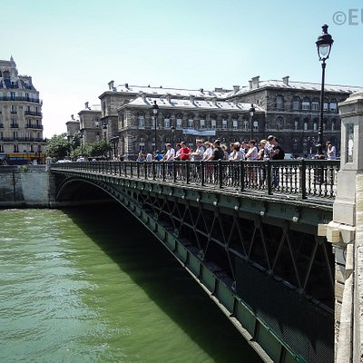 The outside edge of the Pont d'Arcole with its metal work and tourists enjoying the view from th