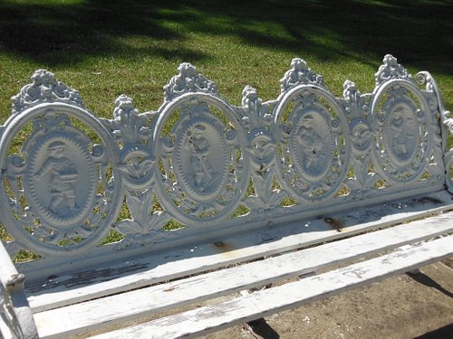 Check out the these old iron benches with the figurines