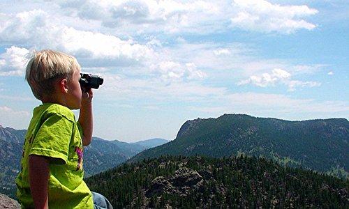 Sitting on the large rock ledge, enjoying the view