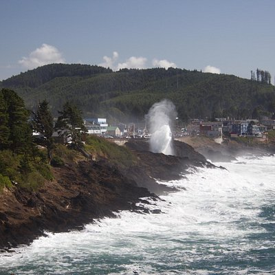 Surf spray over 101 as viewed from Inn at Arch Rock