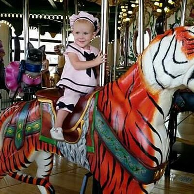 Whit riding the carousel