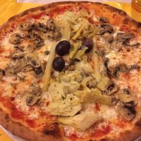 Pizza with olives, artichokes, mushrooms, asparagus