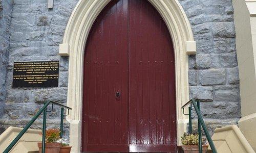 Church door and history plaque