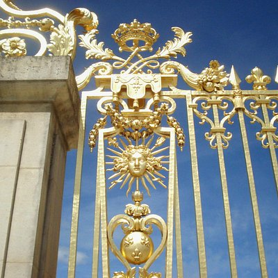 Golden gate with the symbol of Louis XIV at Versailles
