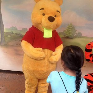Pooh giving my kid's neon-green cooling towel a taste.