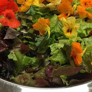 Yummy local greens with fresh flowers