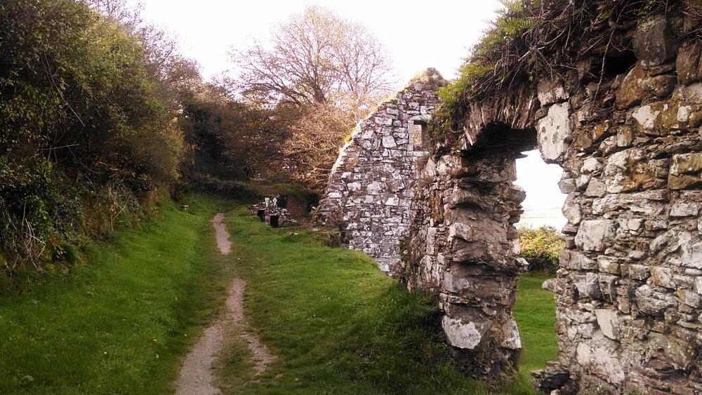 The pathway around the headland through the ruins.