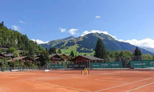 Red clay courts at the Gstaad Palace Hotel