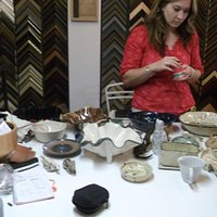 Owner Kathy showing some items