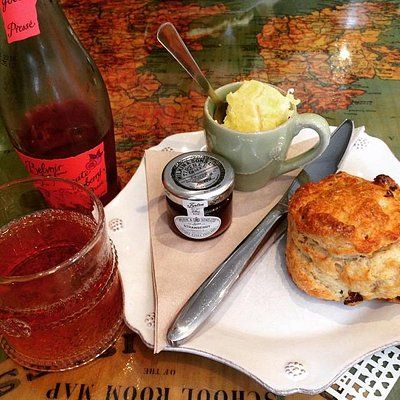 Lovely warm scone with cream and jam!