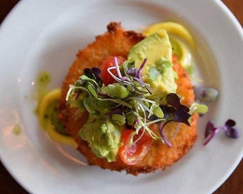 Crispy fried green tomato with microgreen salad