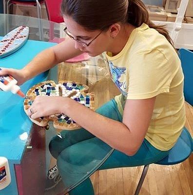 My wife making a sanddollar mosaic