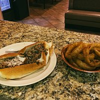 Cheese steak sub and onion rings