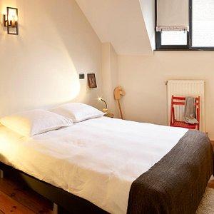Lower floor bedroom in Belka&Strelka Family Duplex