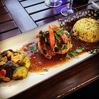 Curried vegetables, seared duck, and couscous