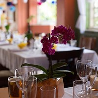 Beautiful tables with lovely tablecloths and fabric napkins