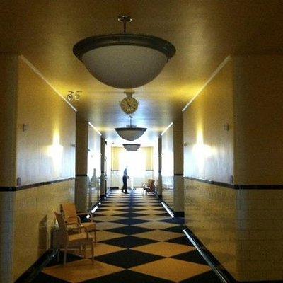 Original tile hallways offer a warm glow