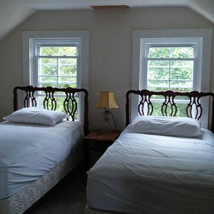 """Two of 3 beds in the """"Bright"""" room."""