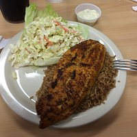 Cajun Catfish on a bed of brown rice with side of coleslaw.