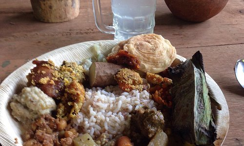 Traditional Goan food served on plates made from beetle but leaf.