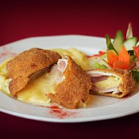 Cordon Bleu – Breaded Chicken breast filled with ham, cheese  served with mashed potato