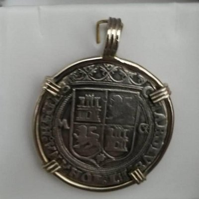 My Coin That I purchased and had made into a pendant to wear.