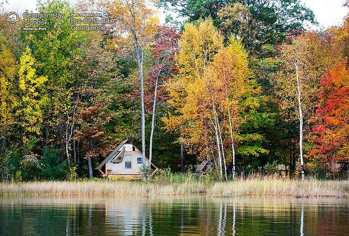 A waterfront oTENTik in Cedar Spring during fall colour season.
