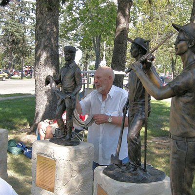 Sculptor Joel Randell from Luther, OK with two of his `13 statues  called the Circle of Time in