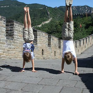 Our clients handstands on the Great Wall