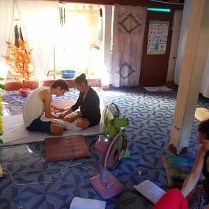 Students practicing Traditional Thai Massage