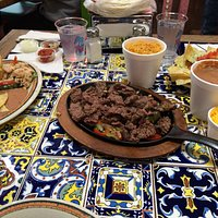 Sizzling Fajita Plate with side dishes