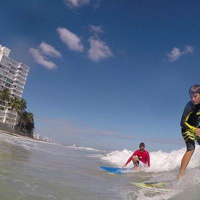 Surf instructor & participant-2