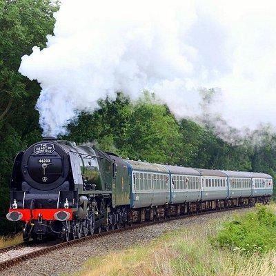 Duchess leaves Wymondham during a Steam Gala