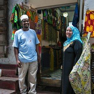 Khatib and Heather outside the shop