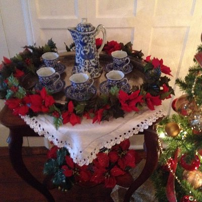 This table is set for a sip of Victorian hot chocolate, chocolate pot and all!
