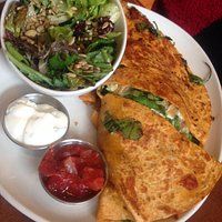 Hot chicken quesadilla with a side of mixed salad
