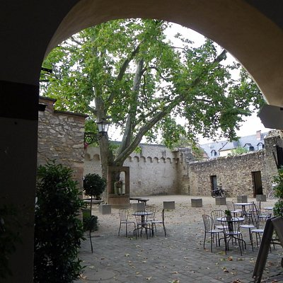 Entrance from the north through the courtyard and tourist information on the far left.