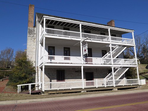 This photo shows the facade of the main house from Netherland Inn Road.